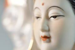 Cara hermosa de Guanyin, aislada en fondo Imágenes de archivo libres de regalías