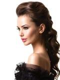 Cara hermosa de una mujer atractiva joven con los pelos largos Imagen de archivo