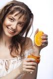 Cara hermosa del `s de la mujer con la naranja fotografía de archivo libre de regalías