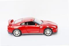 Cara lateral de un coche deportivo modelo rojo Foto de archivo