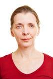 Cara mayor femenina frontal neutral fotografía de archivo
