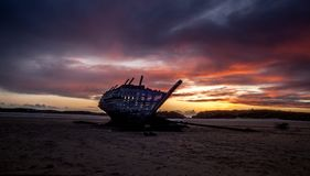 Cara Na Mara Shipwreck on Bunbeg Beach. The Cara na Mara shipwreck at sunset on Bunbeg beach in Donegal, Ireland Royalty Free Stock Photography