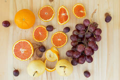 Cara orange and grape on the wooden table ,above view Stock Photos