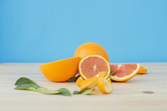Cara orange on wooden table over blue background. Stock Photography