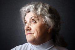 Cara pensativa da avó Fotografia de Stock