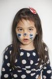 Cara pintada por la mamá foto de archivo libre de regalías