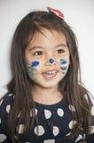 Cara pintada por la mamá imágenes de archivo libres de regalías