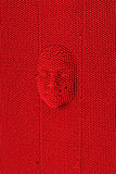 Cara pressionada à placa vermelha da arte do pino foto de stock royalty free