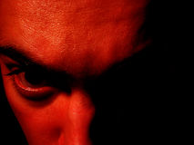 Cara roja del davil Imagenes de archivo