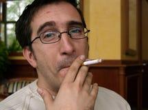 Cara/satisfacción del fumador Foto de archivo libre de regalías