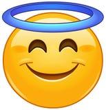 Cara sonriente con el emoticon del halo stock de ilustración