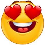 Cara sonriente del emoticon con los ojos del corazón Fotos de archivo
