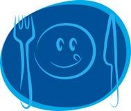 Cara sonriente feliz con la fork y el cuchillo Imagen de archivo
