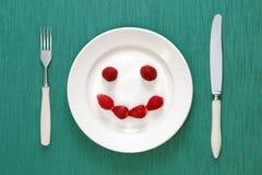 Cara sonriente hecha de fresas Fotos de archivo libres de regalías