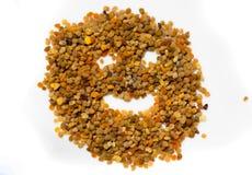 Cara sonriente hecha de los gránulos del polen Natural y salud imágenes de archivo libres de regalías