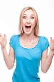 Cara sorprendida de la mujer sobre blanco Imagen de archivo