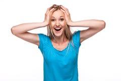 Cara sorprendida de la mujer sobre blanco Fotos de archivo libres de regalías