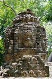 Cara-torres enigmáticas (sorriso de Bayon) do templo de Banteay Chhmar Foto de Stock Royalty Free