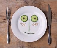 Cara vegetal en la placa - varón, feliz fotografía de archivo libre de regalías