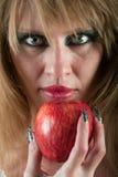Cara y manzana de la mujer Fotografía de archivo