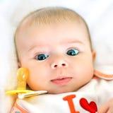 Cara y pacificador del bebé Foto de archivo libre de regalías