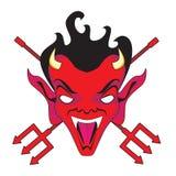 Cara y pitchforks del diablo Imagen de archivo libre de regalías