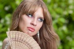 Cara y ventilador de la mujer Imagen de archivo libre de regalías