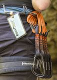 Carabeaners hanging from a rock climbers belt stock photography