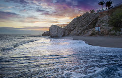Carabeo beach at sunset with fishing hut, Nerja, Spain. Carabeo beach at sunset with fishing hut, Nerja, Malaga, Spain Royalty Free Stock Images