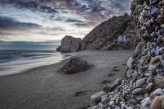 Carabeo beach at sunset with fishing hut, Nerja, Spain. Carabeo beach at sunset with fishing hut, Nerja, Malaga, Spain Royalty Free Stock Image