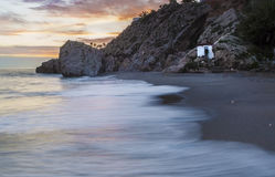Carabeo beach at sunset with fishing hut, Nerja, Spain. Carabeo beach at sunset with fishing hut, Nerja, Malaga, Spain Stock Photography