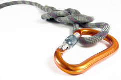 Carabine And Climbing Rope Isolated Agasint A Whit