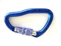 Carabiner. A large, blue screw-gate carabiner. Worn from use. Size *Jumbo* and strength stamped into its side. Isolated on white Stock Image