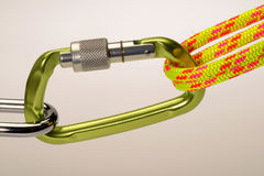 Carabiner and climbing rope locked on Royalty Free Stock Images