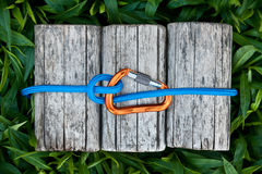 Carabiner with a climbing rope. Carabiner with a climbing rope and a munter hitch knot for descending stock photography