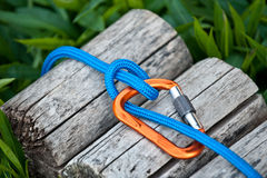 Carabiner with a climbing rope. Carabiner with a climbing rope and a munter hitch knot for descending royalty free stock photos
