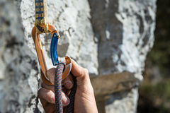 Carabiner and climbing rope Stock Images