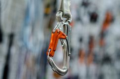 A carabiner or karabiner. Is a specialized type of shackle, a metal loop with a spring-loaded gate used to quickly and reversibly connect components, most stock photography