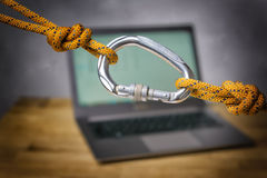 Carabiner with laptop Royalty Free Stock Photo