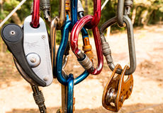 Carabiner and pully for mountaineering. Selection of carabiners, pulleys and a brake Royalty Free Stock Image