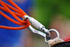 Carabiner on a rope. Climbing sports image of a carabiner on a rope royalty free stock photos