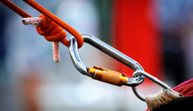 Carabiner on a rope Stock Photography