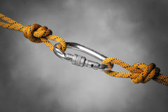 Carabiner with rope. Image of a carabiner hook with a climbing rope stock image