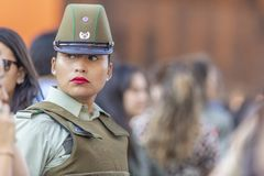 Carabinero police woman portrait at Santiago streets during Women`s Day 8M at Santiago de Chile royalty free stock image