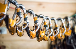Carabiners for climbers hung on a rope Stock Images