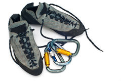 Carabiners and climbing shoes Stock Image