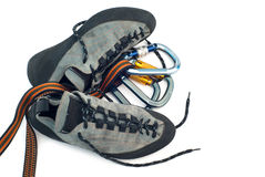 Carabiners and climbing shoes Royalty Free Stock Photos