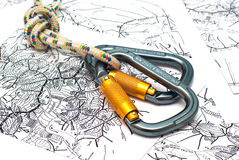 Carabiners on a map background Royalty Free Stock Images