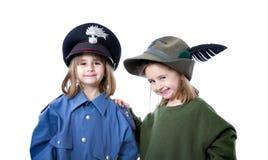 Carabiniere e alpino miltary italiani dei gemelli Fotografia Stock