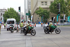 Carabiniers of Chile at Santiago de Chile, Chile. Carabiniers of Chile are riding a motorcycles along the street in Siantiago, Chile. Carabiniers of Chile are stock photo